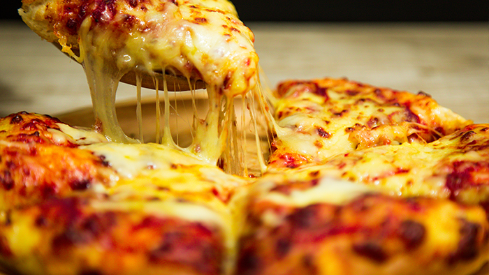 hot-pizza-slice-with-melting-cheese